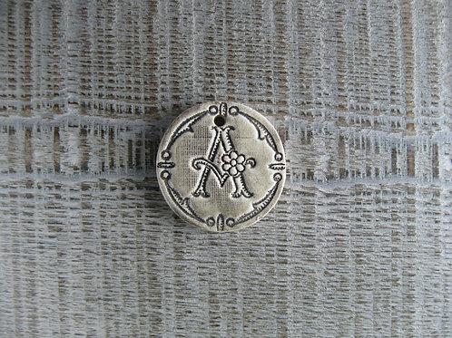 Médaillon rond  initiale