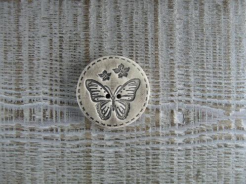 Bouton rond papillon