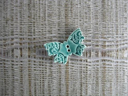 Petit papillon céramique vert turquoise