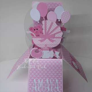 A pink pram for a baby girl