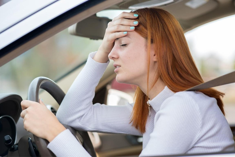 Exhausted teen girl in driver's seat