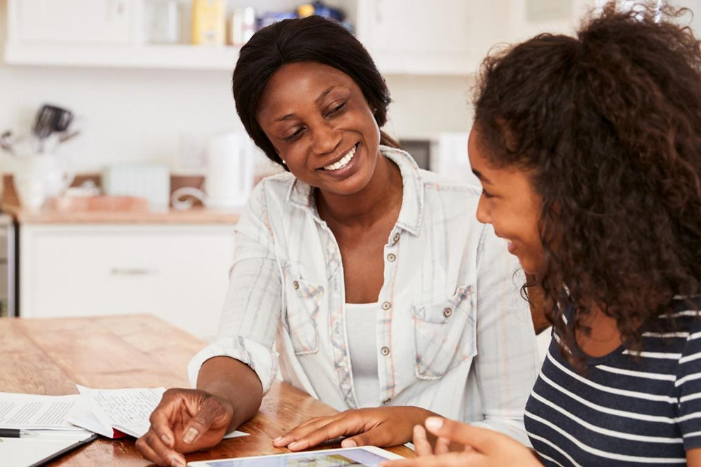 Mom and teen daughter reviewing papers