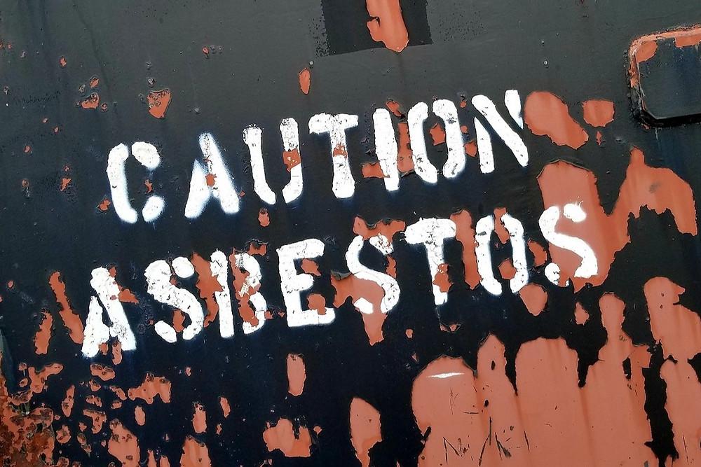 Aviso de perigo contra amianto