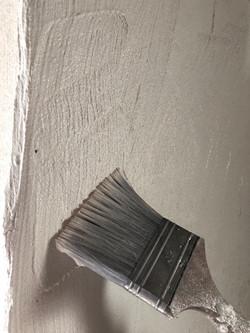 Putz Verarbeitung mit Pinsel