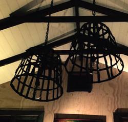 Steel cage pendants