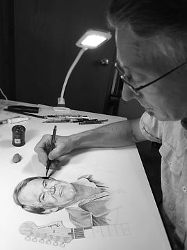 Artist Colin Hayes, working on a drawing of Glen Campbell