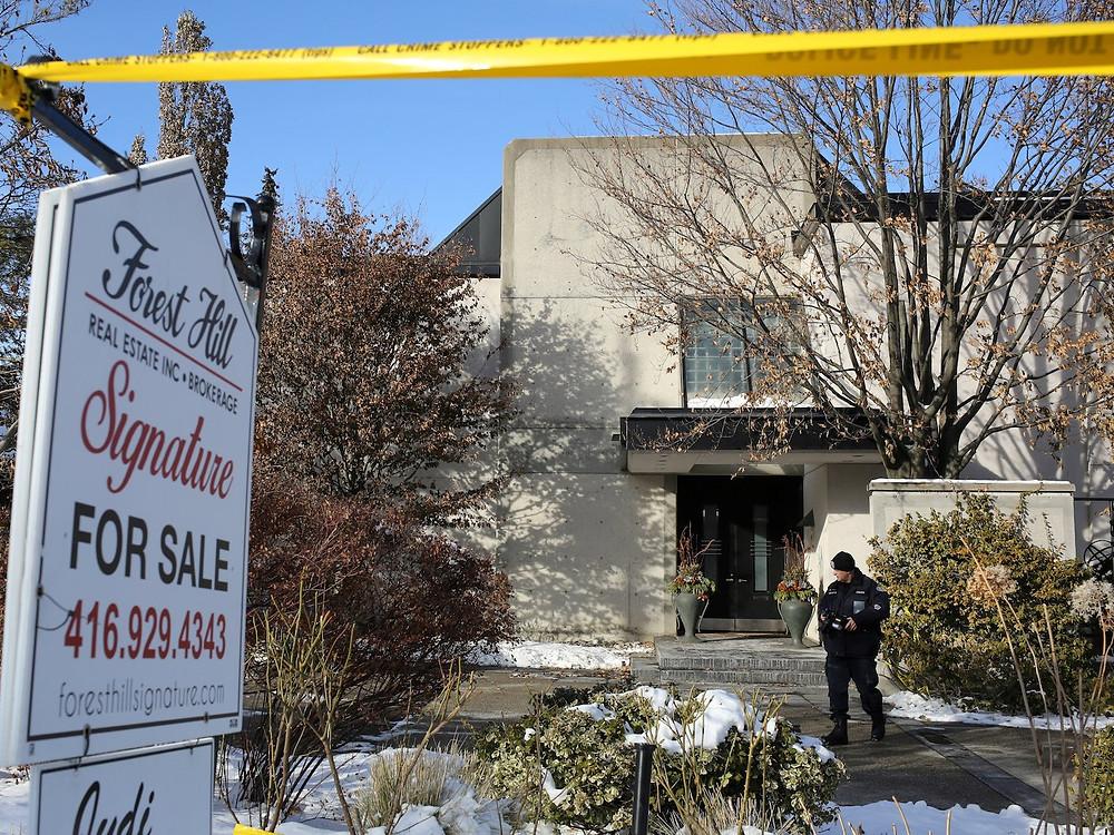 Police outside the Sherman's $5.4 million Toronto mansion. Chris Helgren/Rueters
