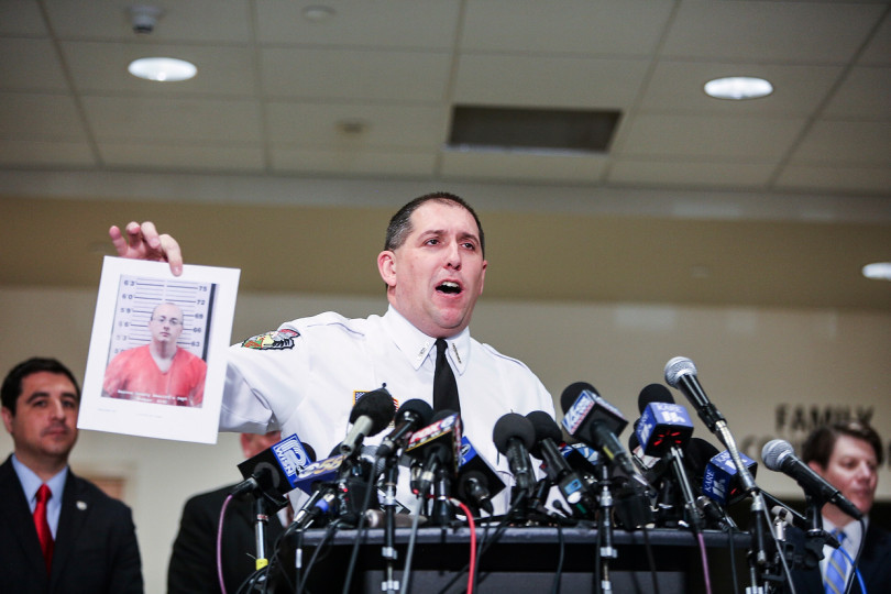 Barron County sheriff holds picture of Jake Patterson, arrested for the kidnapping of Jayme Closs.