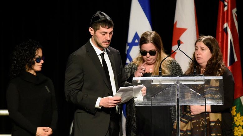 Jonathon Sherman cries as he speaks during a memorial service for his parents Barry and Honey Sherman, as his sisters look on Thursday, December 21, 2017. (Nathan Denette/The Canadian Press)