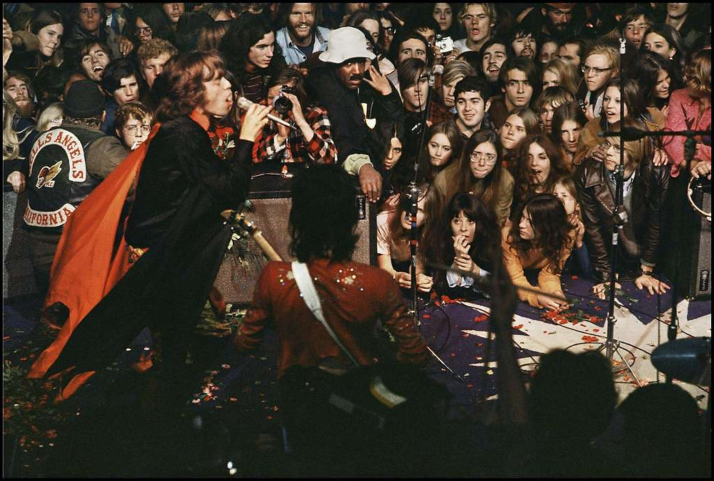 Rolling Stones playing Altamont with Hell's Angels in 1969.