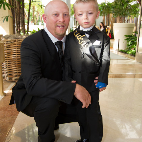 Photo of young child with special needs and his father at UCP-OC's Life Without Limits Gala