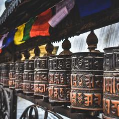 Buddhist prayer wheels and prayer flags