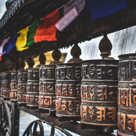 Buddhist prayer wheels and prayer flags