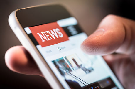 Online news in mobile phone. Close up of