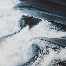 White wave cloulds on the dark ocean waters.