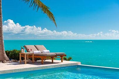 breezy-villa- pool lounge chairs.jpg