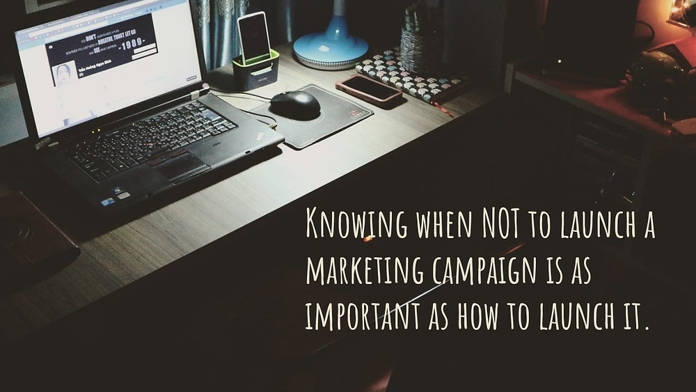 """A desk and computer, with the caption, """"knowing when to launch a marketing campaign is as important as how to launch it"""""""