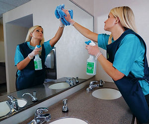 Dayporter_cleaning_mirror_(janitorial) (