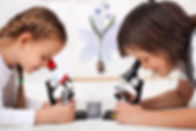 Young kids in science lab study samples