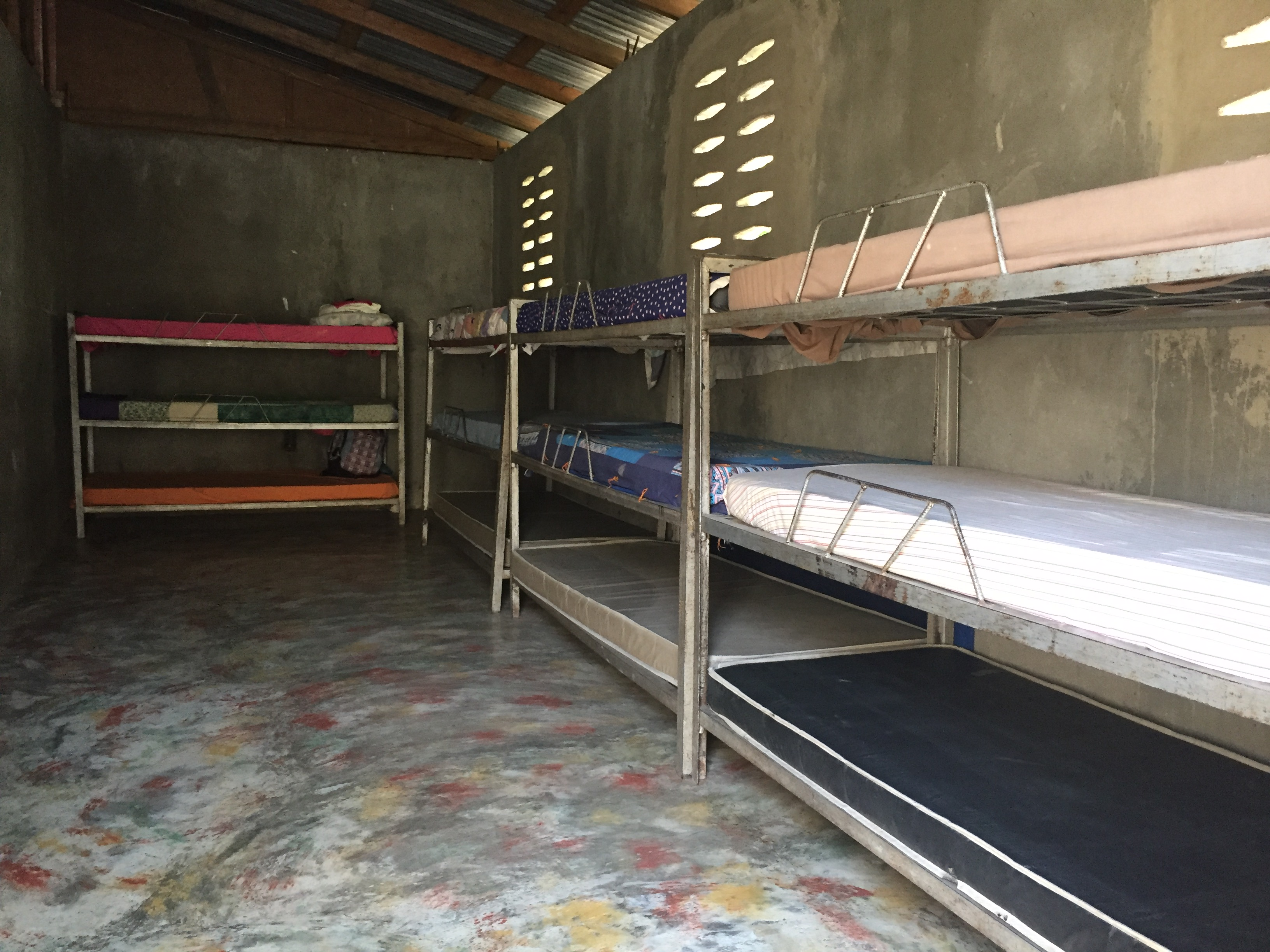 Haitian orphanage boy's bunk area