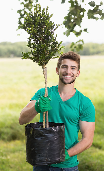 Happy young man gardening for the commun