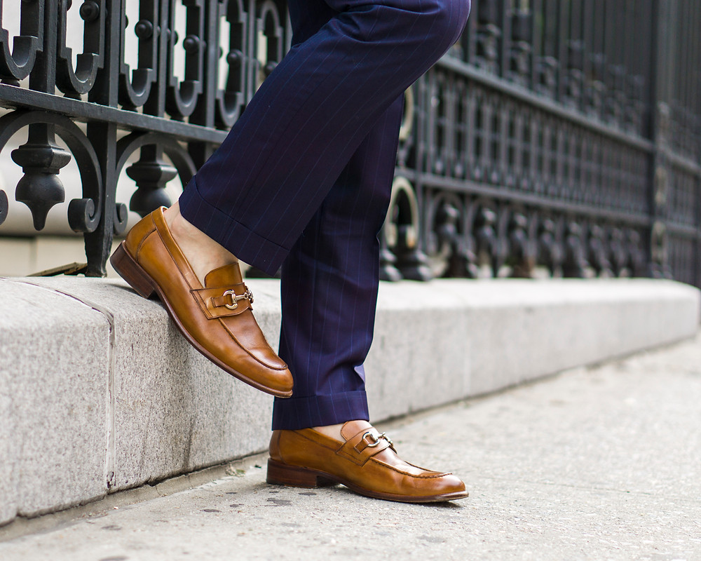 Dapper Professional wearing Eredita loafers.
