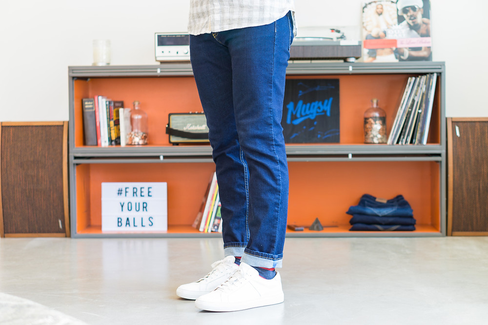 blue denim Mugsy jeans styled casually with white sneakers