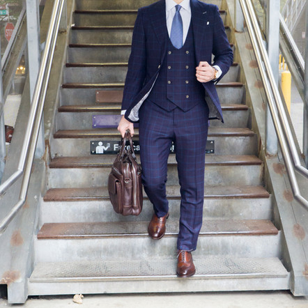 Dapper Professional styling an Indochino Custom Suit for the morning commute in Chicago.
