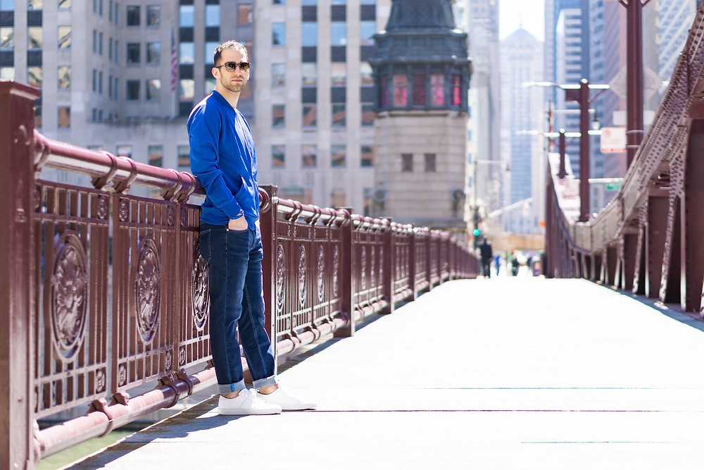 Mugsy denim pictured on the Chicago bridges during spring with white sneakers.