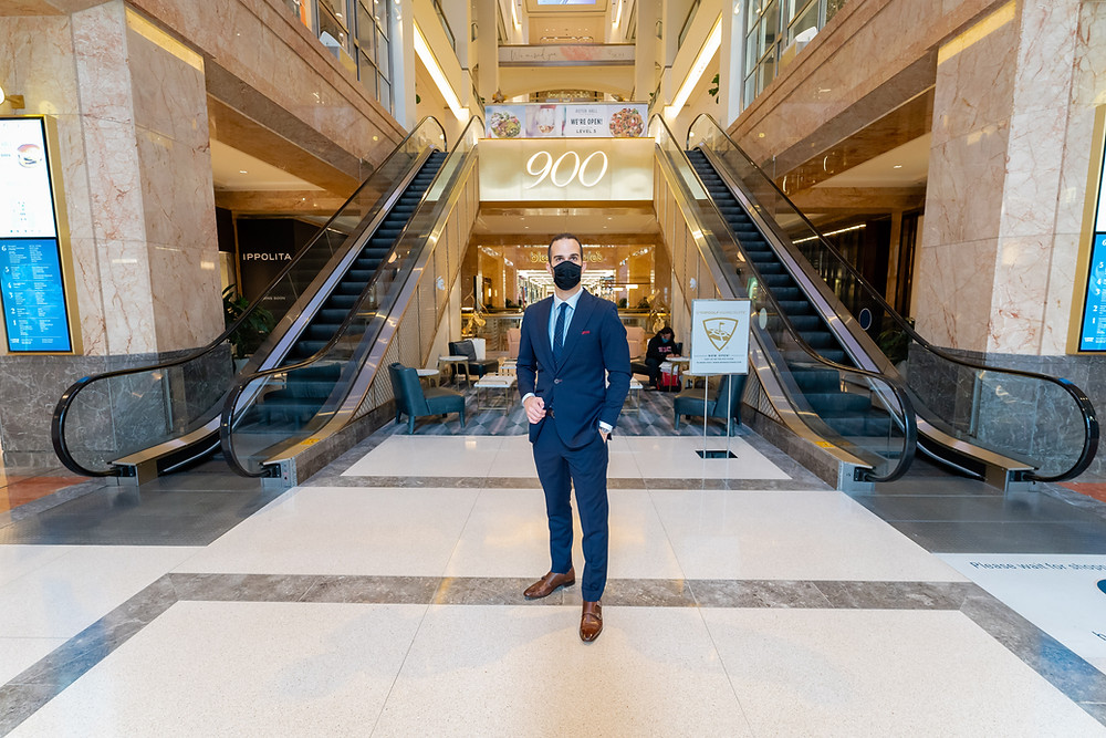 Dapper Professional wearing a suit and shopping and 900 North Michigan Avenue Shops