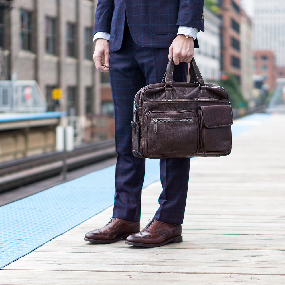 Allen Edmonds Rediscover America Sale featuring a leather briefcase and wingtip shoes