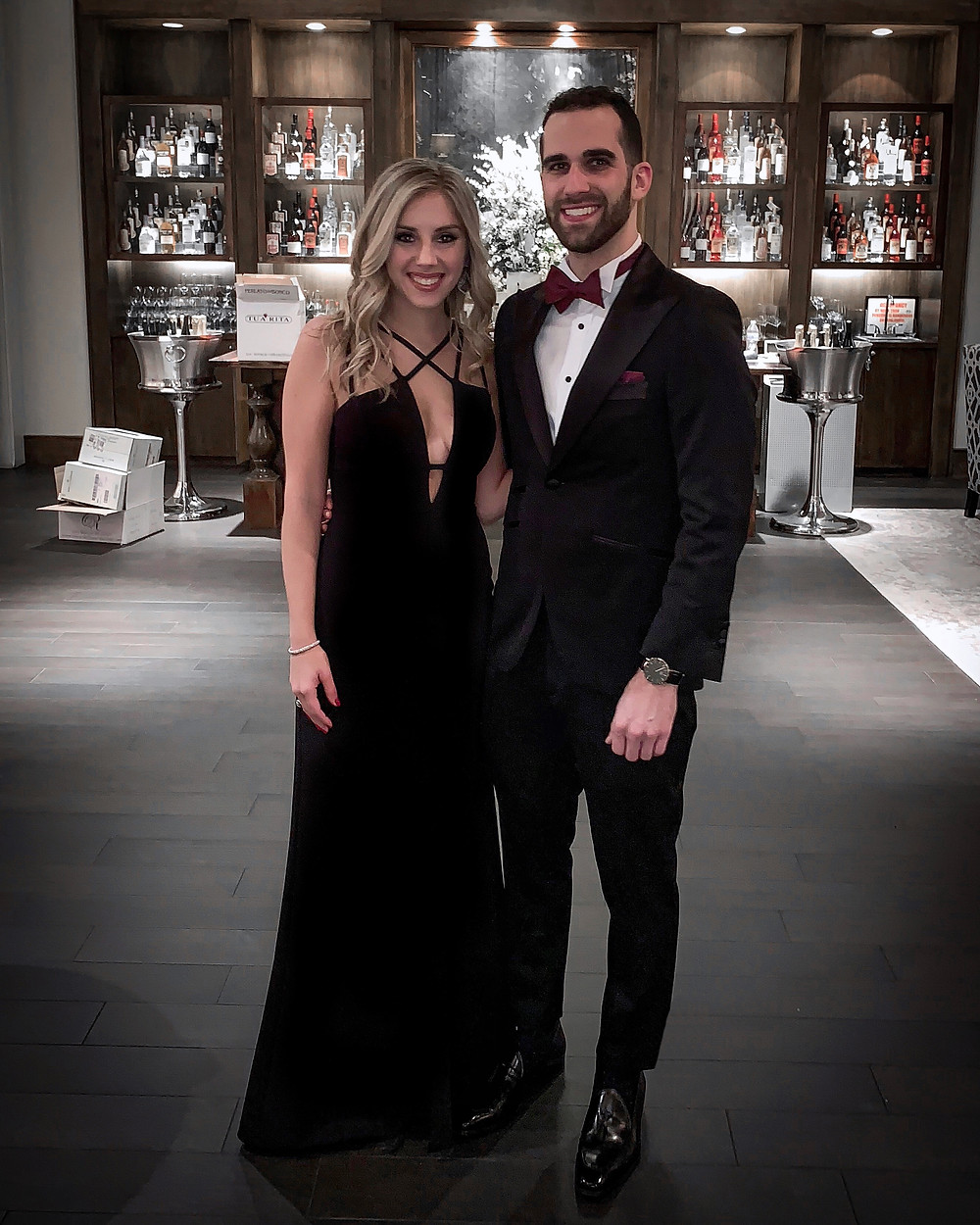 Dapper Professional and his fiancee at a black tie wedding while wearing a Indochino custom tuxedo.