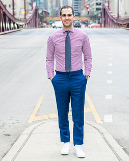Dapper Professional styling a custom fit dress shirt to highlight the importance of fit.