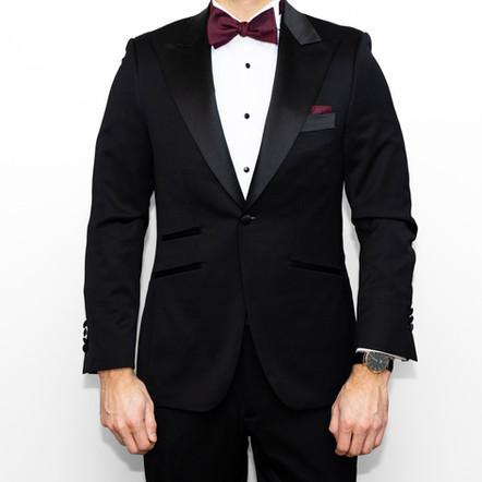 Indochino custom tuxedo styled with a burgundy self-tie bow tie