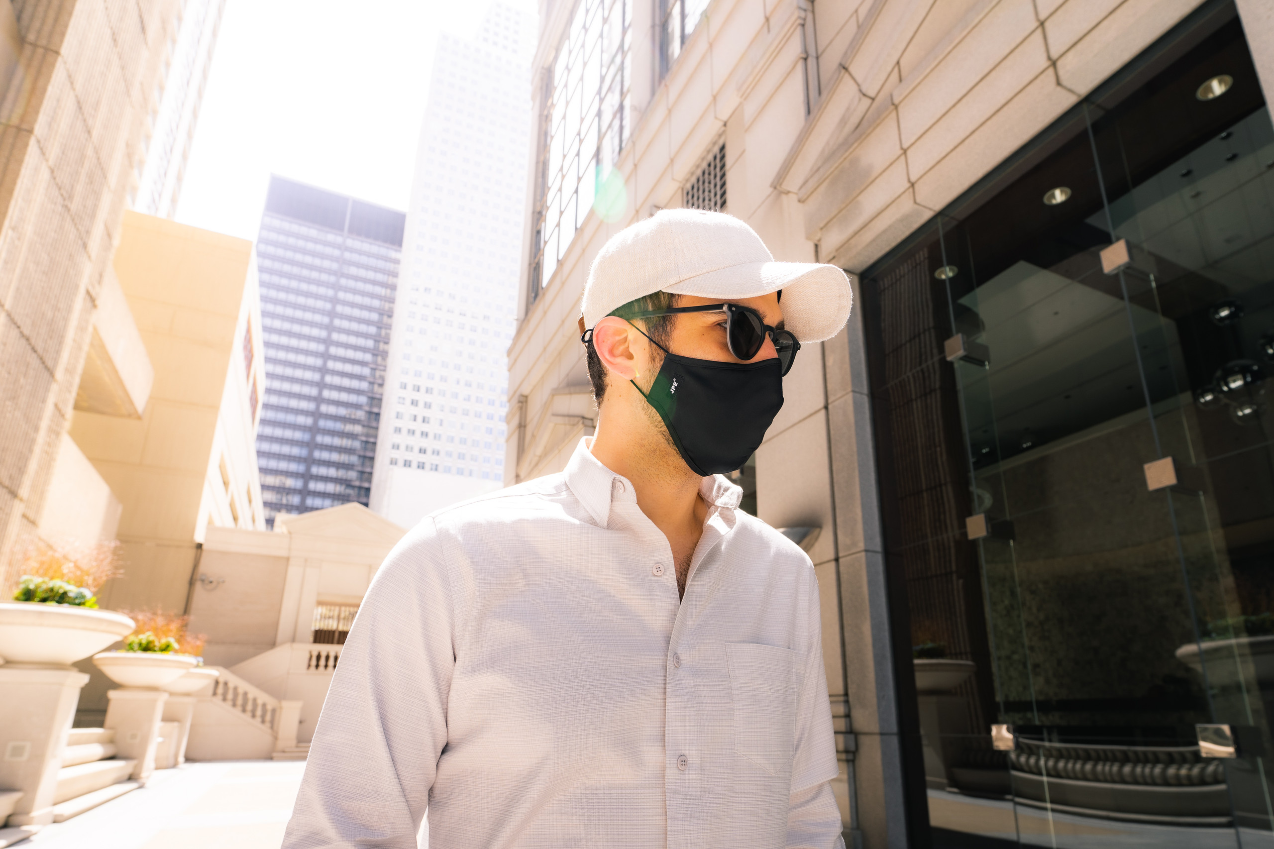Dapper Professional wearing a face mask and a Vandre linen hat.
