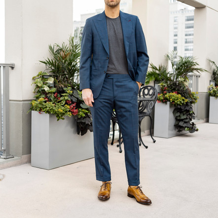 Dapper Professional styling an Indochino custom suit casually with loafers and a t shirt.
