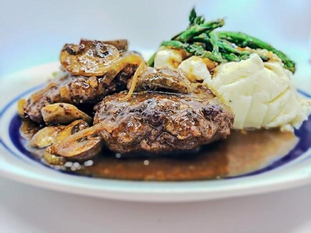 Salisbury steak with gravy mash potatoes green beans and mushrooms