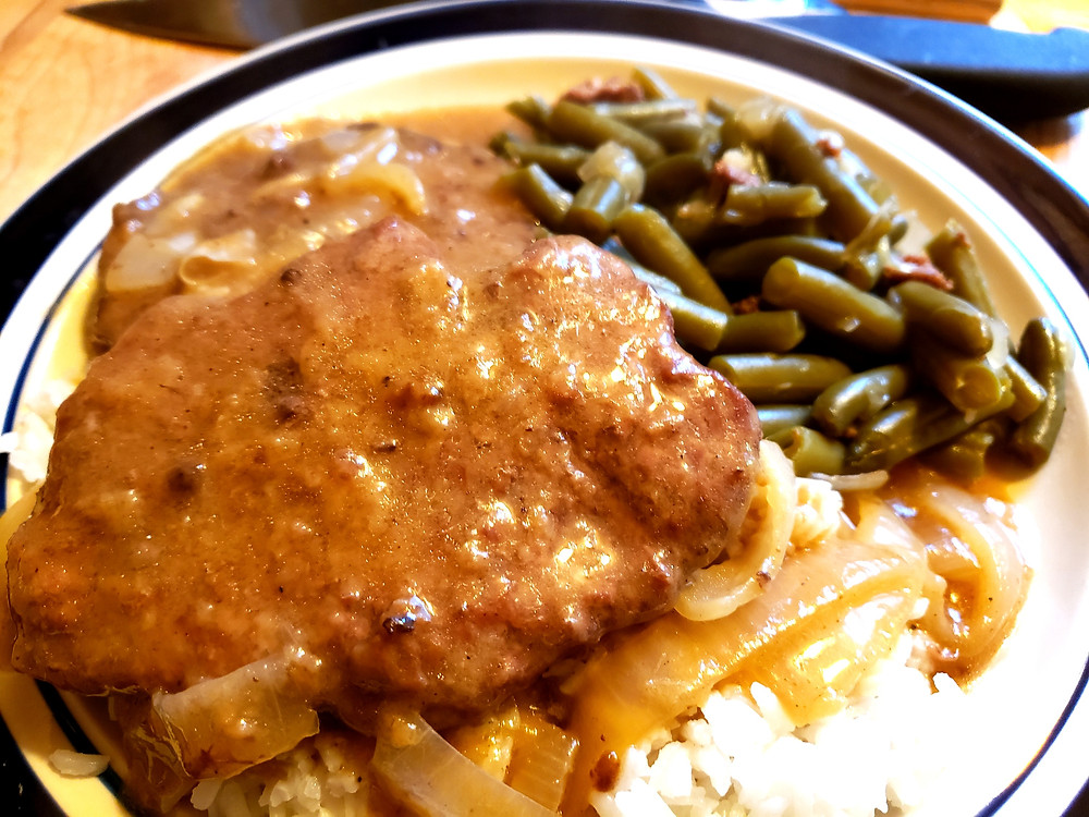 Cube steak country style steak with gravy and mashed potatoes