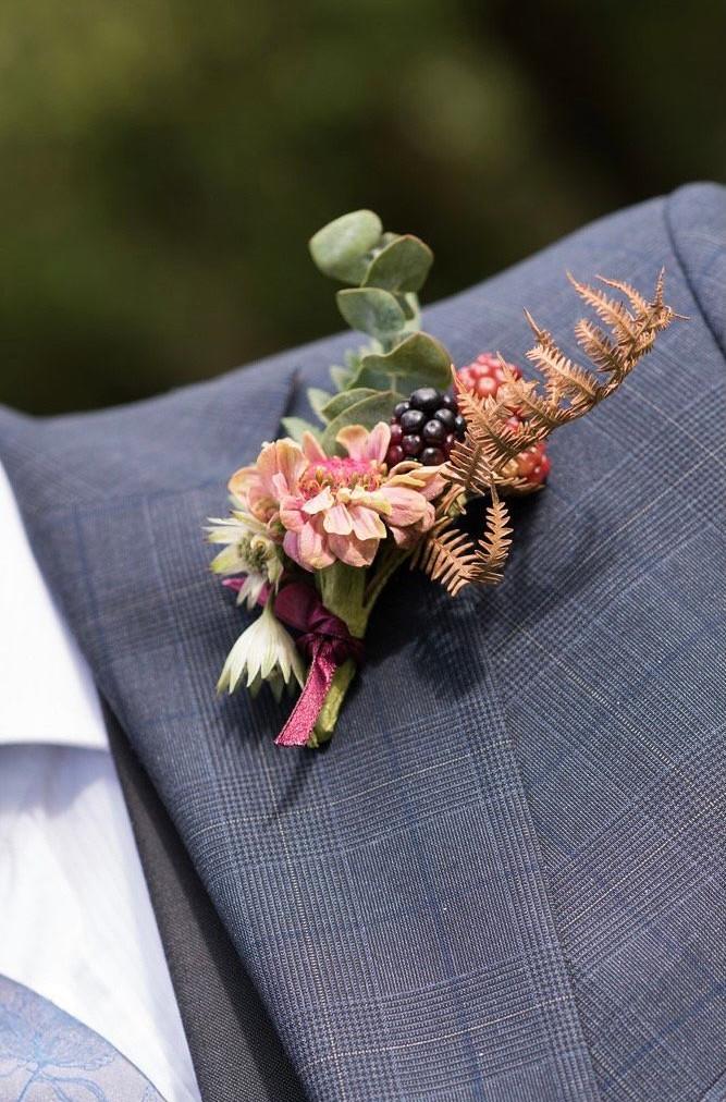 seasonal autumn buttonhole dried and fresh flowers