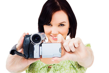 Close-up of a woman holding a home video