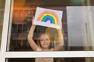 Kid%20painting%20rainbow%20during%20Covi