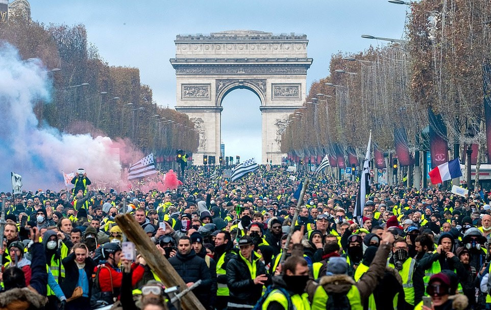 French protesters wear yellow vests as they march in Paris against rising oil prices and living costs near the Arc de Triomphe on the Champs Elysees.  (Image: Olivier Coret/News Pictures/REX/Shutterstock 11/24/18)