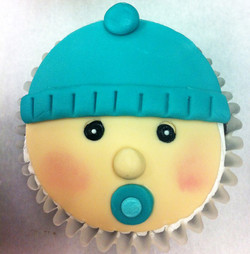 baby with binky cupcake