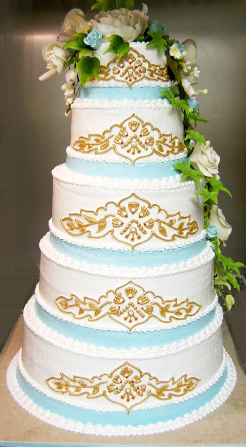 Elegant Gold and Blue Wedding Cake