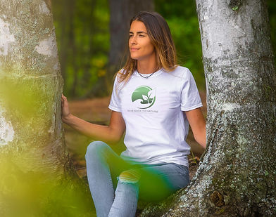 Young beautiful women with a peaceful look sitiing in nature