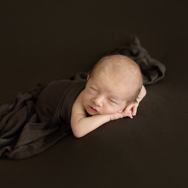 Natural coloured brown blanket with sleeping baby