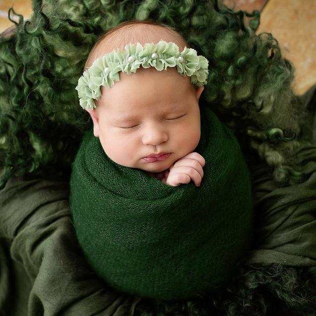 Newborn-Pose-Emerald.png