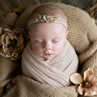 Baby sleeping surrounded by flowers