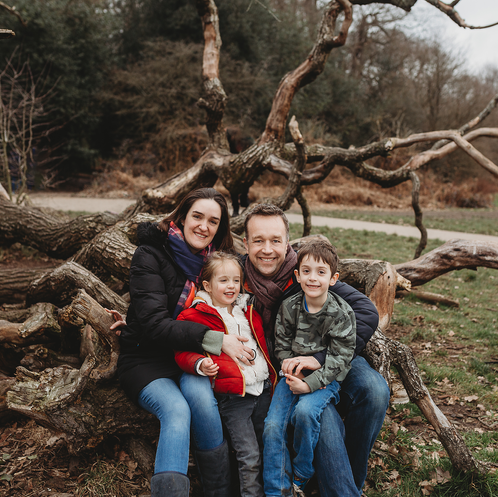 Family portrait in knot of tree in the middle of winter