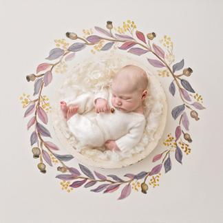 Baby girl wearing soft woollen wromper in artistic wreath
